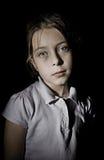 Upset Child against a Black Background royalty free stock image