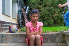 Upset child gypsy girl don't want to play with other children Stock Photography