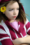 Upset child with yellow flower portrait Stock Photography