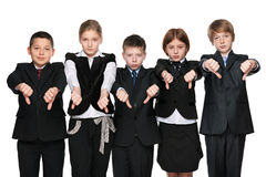 Upset children hold his thumbs down Stock Image