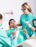 Upset client in dental clinic Royalty Free Stock Images