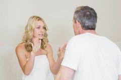 Upset couple having an argument Stock Images