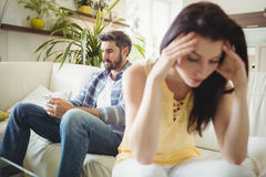 Upset couple ignoring each other on sofa Royalty Free Stock Images