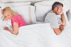Upset couple lying back to back Royalty Free Stock Images
