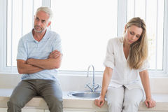 Upset couple not talking after an argument Stock Photos