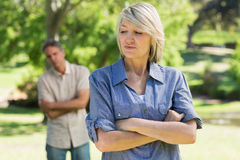Upset couple in park stock image