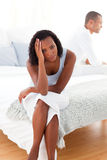 Upset couple sitting on the bed Royalty Free Stock Images