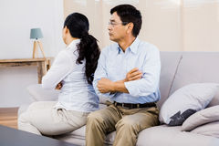 Upset couple sitting on the couch Royalty Free Stock Photo