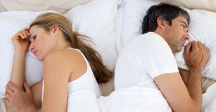 Upset couple sleeping separately