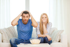 Upset couple after sports team loss Royalty Free Stock Image