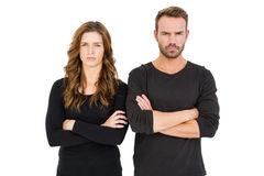 Upset couple standing with arms crossed royalty free stock photos