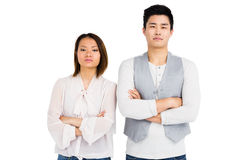 Upset couple standing with arms crossed Stock Images