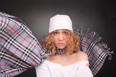 Upset curly woman in hat with scarf waving Stock Photography