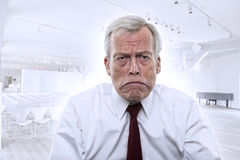 Upset Caucasian businessman with huge frown royalty free stock photography