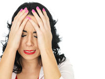 Upset Depressed Emotional Young Hispanic Woman Holding Her Head in Her Hands. Upset Depressed Worried Young Woman with long black curly hair and hispanic or Royalty Free Stock Images