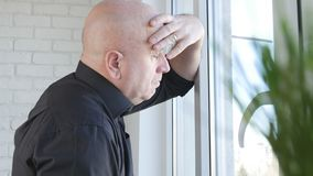 Upset and Disappointed Businessman Looking Worried on the Window royalty free stock photography