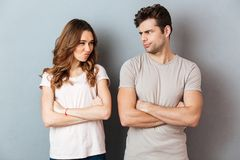 Upset disappointed couple standing with arms Royalty Free Stock Photography