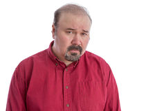 Upset and disappointed frowning middle-aged man. Upset and disappointed bald frowning middle-aged man looking at camera with a depressed facial expression Royalty Free Stock Photography