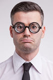 Upset and disappointed nerd clerk Royalty Free Stock Image