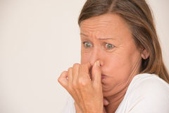 Upset disgusted woman nose covering Stock Images