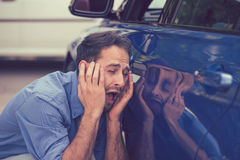 Upset driver after car accident stock image