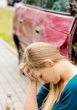 Upset driver woman in front of automobile crash car. Stock Photo