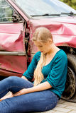 Upset driver woman in front of automobile crash car. Royalty Free Stock Photography