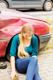 Upset driver woman in front of automobile crash car. Stock Photos