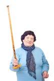 Upset elderly woman showing her stick. Upset elderly woman showing her walking stick isolated on white background royalty free stock photos
