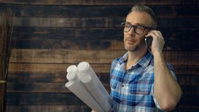 Upset engineer talking on phone. With contractor or architect stock footage
