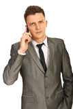 Upset executive by phone mobile Stock Images