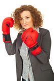Upset executive woman with boxing gloves Stock Photography