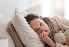 Upset exhausted woman suffering from an illness Stock Photo