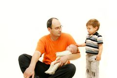 Upset father with two children Stock Photography