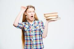 Upset female student holding books Royalty Free Stock Image
