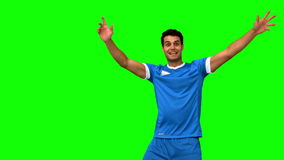 Upset football player disagreeing with the referee on green screen stock video