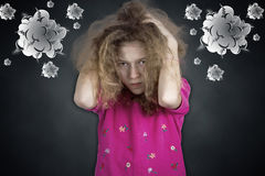 Upset frustrated little girl pullling her hair out Stock Photos