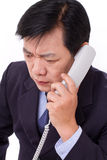 Upset, frustrated manager receiving bad news via telephone call. White isolated Stock Images