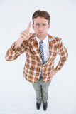 Upset geeky hipster pointing at camera Stock Photography
