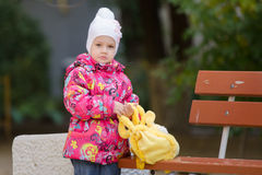Upset girl in autumn clothes shops costs about Stock Photos