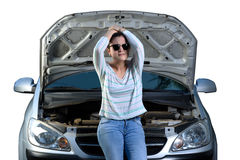 Upset girl with broken car Royalty Free Stock Photos
