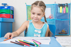 Upset girl draws with crayons Royalty Free Stock Images