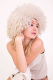 Upset girl in furry hat Royalty Free Stock Images