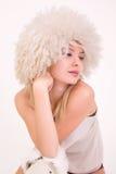 Upset girl in furry hat. Studio shot royalty free stock images