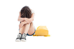 Upset girl holding head on knees Royalty Free Stock Photo
