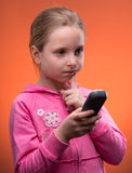 Upset girl holding phone Royalty Free Stock Image