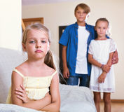 Upset girl  is jealous sister of stepbrother Stock Photography