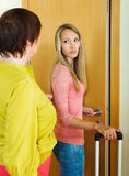 Upset girl   leaving apartment of mother Stock Image