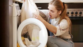 Upset girl looking at stains. On towels after laundry stock video footage