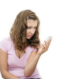 Upset girl with phone Royalty Free Stock Image